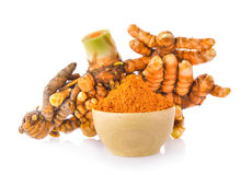 Turmeric root and dry tumeric in wood bowl Stock Photo