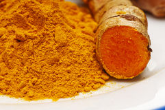 Turmeric, root and powder Royalty Free Stock Photography