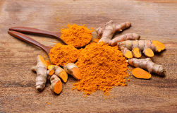 Turmeric root and powder Royalty Free Stock Image