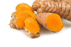 Turmeric root and some slices. On a white background Stock Images