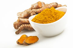 Turmeric root and some slices. On a white background Stock Photography