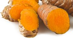Turmeric root and some slices. On a white background Royalty Free Stock Images