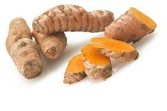 Turmeric root and some slices stock image