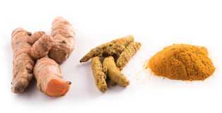 Turmeric root on white background Stock Photos