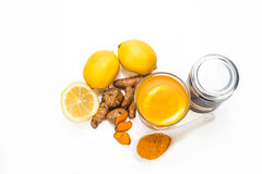 Turmeric roots with lemon and honey drinks, powerful healing bev Stock Image