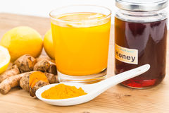 Turmeric roots with lemon and honey drinks, powerful healing bev Royalty Free Stock Images