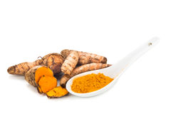 Turmeric roots and powder, healthy food with healing properties. Royalty Free Stock Photo