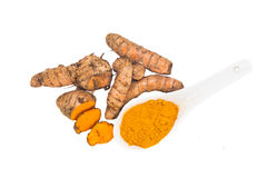 Turmeric roots and powder, healthy food with healing properties. Royalty Free Stock Photos