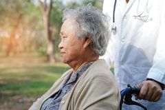 Turmeric roots and powder herbDoctor help and care Asian senior or elderly old lady woman patient sitting on wheelchair. Doctor help and care Asian senior or royalty free stock photography