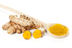 Turmeric roots and powder on spoon Royalty Free Stock Image