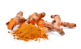 Turmeric roots with turmeric powder isolated on white background Stock Photo