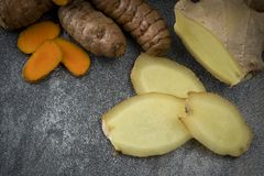 Turmeric slices and ginger root royalty free stock photography