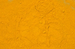 Turmeric spice background texture. Dried turmeric spice background texture Stock Photography