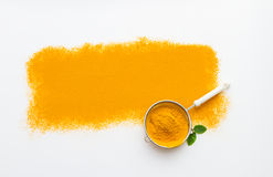 Turmeric spices on white texture background. Stock Photos