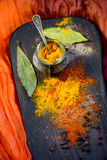 Turmeric with spices on a wooden Board Royalty Free Stock Images