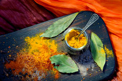 Turmeric with spices on a wooden Board Stock Photo