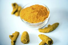 Turmeric. In Bowl isolated  Powder stock images
