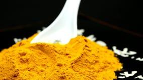 Turmeric on a turn table. Turmeric powder on a turn table stock video