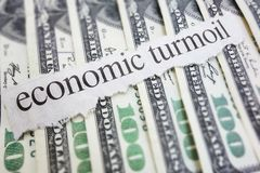 Turmoil. Economic Turmoil newspaper headline on cash Royalty Free Stock Image