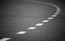 Turn. Ing asphalt road with marking lines. Close up photo Royalty Free Stock Photos