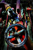 Turn On. An old red fire pipes taken in an abandon place. Strong contrast and textures Stock Photo