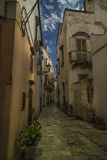 Turn around the Italian alleys. A tipical Italian alley in an old quarter of Gallipoli Royalty Free Stock Image