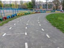 Turn the asphalt road running at the school stadium.  Stock Photos