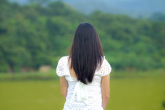 Turn back. Woman turned back to look at nature royalty free stock photos