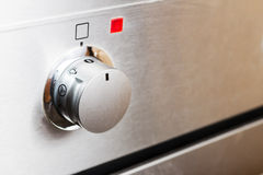 Turn baking oven off Stock Photography