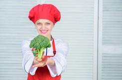 Turn broccoli into favorite ingredient. How to cook broccoli. Raw food diet. Broccoli nutrition value. Woman. Professional chef hold raw broccoli vegetable stock images