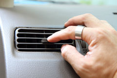 Turn the car air conditioner vents Stock Photo