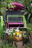Turn-of-the-Century Flowerbed. This turn-of-the-century carriage has been repurposed to transport beauty in the form of flowers and plants for visitors viewing Royalty Free Stock Image