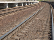 Turn double-track railway sun day. Two paintings by rail railroad royalty free stock image