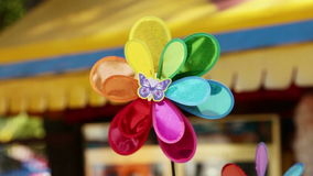 Turn flower. Rotating flower. Multicolored artificial flower spinning in the wind stock footage
