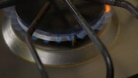 Turn on the gas stove. close-up. Slow motion stock video footage