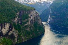 Turn of Geirangerfjord near craggy rocks Stock Image