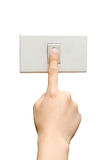 Turn on. A hand pushing a button on the wall Royalty Free Stock Image