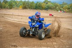 Turn at high speed. SERPUKHOV, RUSSIA - OCTOBER 7, 2017: Nikolaev Maksim 13,  Class ATV-JUNIORS, in the 4 stage  MX series, the Red Wings Cup 2017 super country Royalty Free Stock Photography
