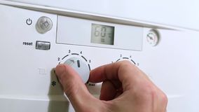 Turn on the house gas heating boiler. Hand turn on the house gas heating boiler stock video