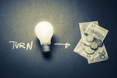 Turn idea to money. Concept, light bulb as symbol of creativity Stock Images