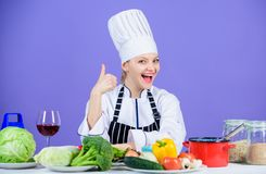 Turn ingredients into delicious meal. Culinary skills. Woman chef wear hat apron near table ingredients. Girl adorable royalty free stock photo