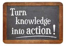 Turn knowledge into action. Motivational advice on a vintage slate blackboard Royalty Free Stock Image