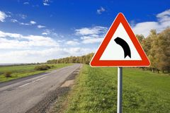 Turn Left. Road sign in rural area Royalty Free Stock Photos