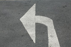 Turn left arrow on asphalt street Royalty Free Stock Photo