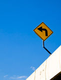 Turn left sign with blue sky. Which is on the road Royalty Free Stock Photography