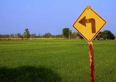 Turn left sign to rice feild Royalty Free Stock Photo