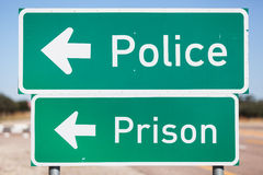 Turn left to police and prison Stock Photos