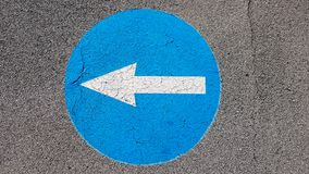 Turn left traffic road sign symbol with white arrow pointing left royalty free stock photo