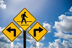 Turn left and turn right sign and a man walking si Stock Images