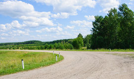 Turn of the lonely road in countryside Stock Images